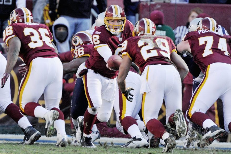 The Redskins used fullback Darrel Young (36) as a blocker for Roy Helu (29) in Fred Davis' absence. The move paid off as Helu posted his third straight 100-yard game. Unofficially, Young was on the field for 42 of 69 plays. (Preston Keres/Special to The Washington Times)