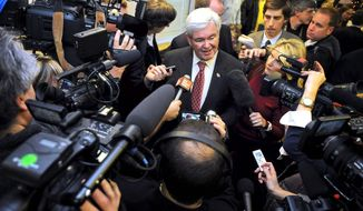 Newt Gingrich, answering media questions in South Carolina in November, has made a point of ridiculing the press during his presidential campaign, but without the free coverage he's received, his money-challenged campaign might never have gotten off the ground. (Associated Press)