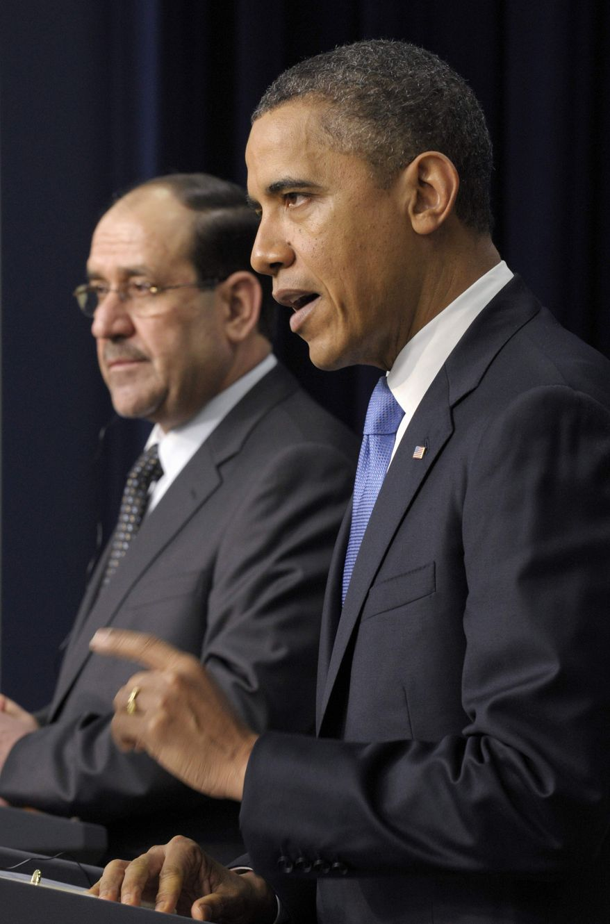 President Obama, accompanied by Iraqi Prime Minister Nouri al-Maliki, speaks during a news conference at the White House on Dec. 12, 2011. (Associated Press) ** FILE **