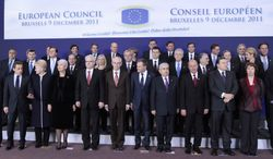 EU heads of state pose for a group photo at an EU summit in Brussels on Friday, Dec. 9, 2011. First row from left to right: European Parliament President Jerzy Buzek, French President Nicolas Sarkozy, Lithuania's President Dalia Grybauskaite, Croatia's Prime Minister Jadranka Kosor, Croatia's President Ivo Josipovic, European Council President Herman Van Rompuy, Poland's Prime Minister Donald Tusk, Cypriot President Dimitris Christofias, Romania's President Traian Basescu, European Commission President Jose Manuel Barroso, EU foreign policy chief Catherine Ashton, and European Council Secretary-General Uwe Corsepius. Second row left to right: Bulgarian Prime Minister Boyko Borissov, Estonia's Prime Minister Andrus Ansip, British Prime Minister David Cameron, Malta's Prime Minister Lawrence Gonzi, Slovakia's Prime Minister Iveta Radicova, Luxembourg's Prime Minister Jean-Claude Juncker, Latvian Prime Minister Valdis Dombrovskis, Italy's Prime Minister Mario Monti, Greek Prime Minister Lucas Papademos, Irish Prime Minister Enda Kenny, Denmark's Prime Minister Helle Thorning-Schmidt. Top row left to right: Hungarian Prime Minister Viktor Orban, Belgium's Prime Minister Elio Di Rupo, Spain's Prime Minister Jose Luis Rodriguez Zapatero, Swedish Prime Minister Fredrik Reinfeldt, German Chancellor Angela Merkel, Czech Republic's Prime Minister Petr Necas, Slovenia's Prime Minister Borut Pahor, Portugal's Prime Minister Pedro Passos Coelho, Finland's Prime Minister Mari Kiviniemi, Austrian Chancellor Werner Faymann, and Dutch Prime Minister Mark Rutte. (AP Photo/Yves Logghe)