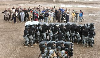 **FILE** Iraqi police officers demonstrate anti-riot policing techniques during a training session Nov. 25, 2009, at Camp Dublin in Baghdad, Iraq. The Italian Carabinieri police team, a part of the NATO Training Mission to Iraq, conducted the specialized training for the Iraqi National police. (Associated Press)