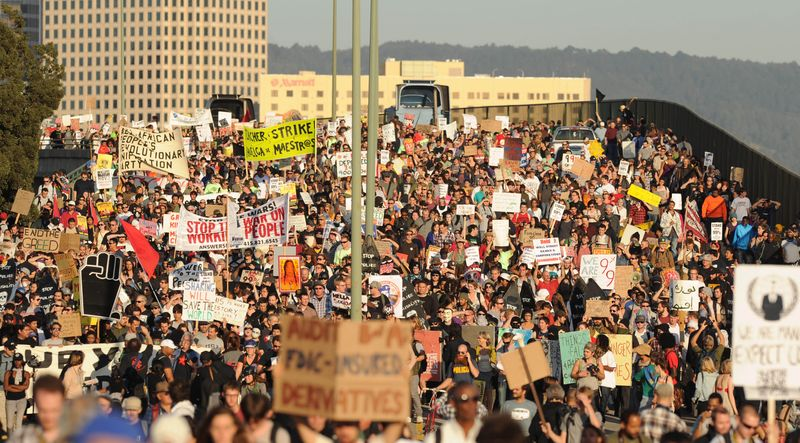**FILE** Occupy Oakland protesters march through the Port of Oakland, Calif., on Nov. 2, 2011. (Associated Press)