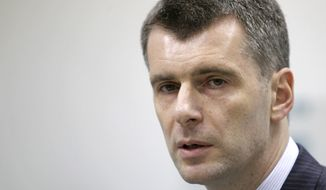 Mikhail Prokhorov, one of Russia's richest tycoons and the owner of the New Jersey Nets, announces his candidacy to run against Prime Minister Vladimir Putin for Russia's presidency on Monday, Dec. 12, 2011, in Moscow. (AP Photo/Misha Japaridze)