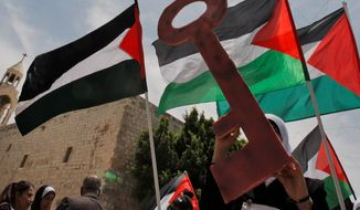 Palestinians demonstrate for statehood in Manger Square outside the Church of the Nativity in the West Bank city of Bethlehem in May. Now at Christmastime, Palestinians in Jesus' traditional birthplace of Bethlehem are aiming to re-energize their bid for recognition. (Associated Press)