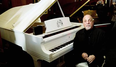 Billy Joel appears at Steinway Hall in New York on Monday, when his portrait was unveiled, to be hung among portraits of greats including Franz Liszt. (Associated Press)