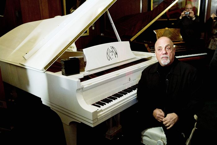 Billy Joel appears at Steinway Hall in New York on Monday, when his portrait was unveiled, to be hung among portraits of greats including Franz Liszt. (Associate