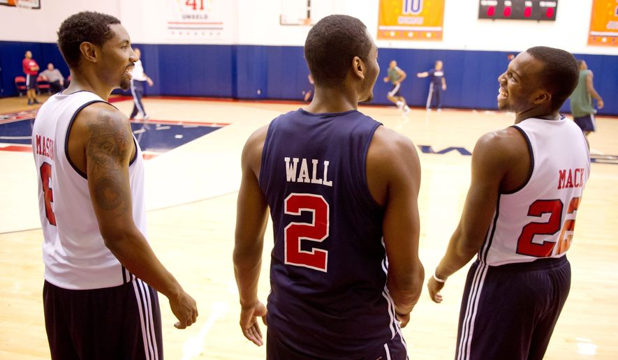"Washington Wizards guards Roger Mason (8), John Wall (2) and Shelvin Mack (22) train and spend time together off the court nearly every day. ""I think our chemistry is going really well together,"" Mack said. (Andrew Harnik / The Washington Times)"