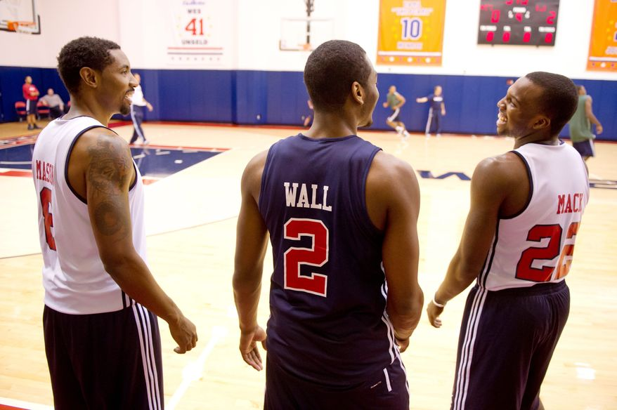 """Washington Wizards guards Roger Mason (8), John Wall (2) and Shelvin Mack (22) train and spend time together off the court nearly every day. """"I think our chemistry is going really well together,"""" Mack said. (Andrew Harnik / The Washington Times)"""