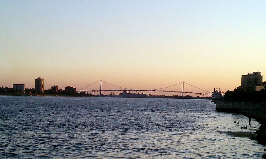 Ambassador Bridge links downtown Detroit and Windsor, Canada. Manuel Moroun, the owner of the aging structure, mounted a million-dollar ad campaign to sway state voters against a new bridge project connecting Detroit and Canada. (Associated Press)