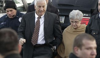 ** FILE ** Jerry Sandusky (left), the former Penn State assistant football coach charged with sexually abusing boys, arrives with his wife, Dottie, at the Centre County Courthouse in Bellefonte, Pa., on Tuesday, Dec. 13, 2011. (AP Photo/Gene J. Puskar)