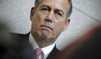 House Speaker John Boehner, Ohio Republican, meets Dec. 13, 2011, with reporters on Capitol Hill before a crucial vote on a GOP effort to renew an extension of the payroll-tax cut. (Associated Press)