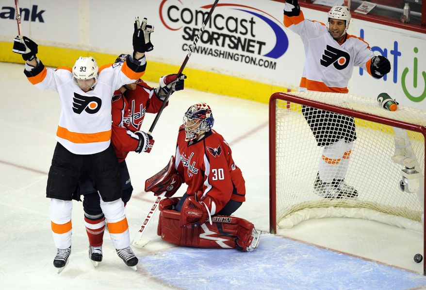 Philadelphia Flyers right wing Jakub Voracek (93) celebrates his goal as Washington Capitals goalie Michal Neuvirth reacts during the third period of an NHL game, Tuesday, Dec. 13, 2011, in Washington. (AP Photo/Nick Wass)