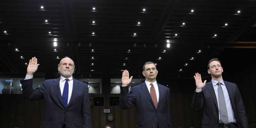 From left: Jon Corzine, former MF Global Holdings Ltd. chairman and CEO; Bradley Abelow, MF Global president and COO; and Henri Steenkamp, MF Global CFO, are sworn in Dec. 13, 2011, on Capitol Hill prior to testifying before the Senate Agriculture Committee. (Associated Press)