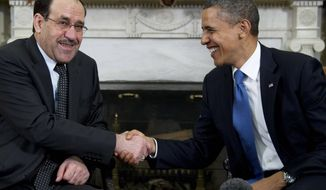 President Barack Obama meets with Iraq's Prime Minister Nouri al-Maliki in the Oval Office of the White House in Washington, Monday, Dec. 12, 2011. (AP Photo/Carolyn Kaster)