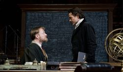 "Jared Harris (left) plays Professor James Moriarty, the renowned nemesis to Robert Downey Jr.'s title character in ""Sherlock Holmes: A Game of Shadows."" The sequel from director Guy Ritchie opens Friday in North America. (Warner Bros. Pictures via Associated Press)"