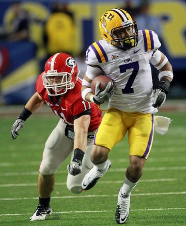 LSU cornerback Tyrann Mathieu (7) returns a punt for a touchdown as Georgia's Connor Norman defends during the first half of the Southeastern Conference championship NCAA college football game, Saturday, Dec. 3, 2011, in Atlanta. (AP Photo/John Bazemore)