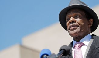 D.C. Council member Marion Barry, who owes the federal government more than $277,000 in back taxes, interest and penalties, answers questions of reporters after leaving the federal court house where he testified in Washington, D.C., Thursday, April 16, 2009. (Astrid Riecken/The Washington Times)
