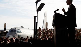 "President Obama speaks to returning troops at Fort Bragg, N.C., Wednesday, about the end of the Iraq war with the withdrawal of all U.S. forces at the end of this month. ""Our commitment [to you] doesn't end when you take off the uniform,"" Mr. Obama said. (Associated Press)"