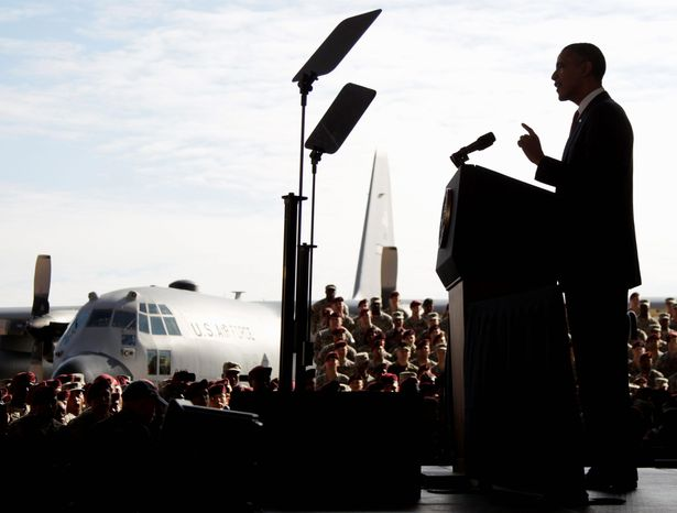 """President Obama speaks to returning troops at Fort Bragg, N.C., Wednesday, about the end of the Iraq war with the withdrawal of all U.S. forces at the end of this month. """"Our commitment [to you] doesn't end when you take off the uniform,"""" Mr. Obama said. (Associated Press)"""