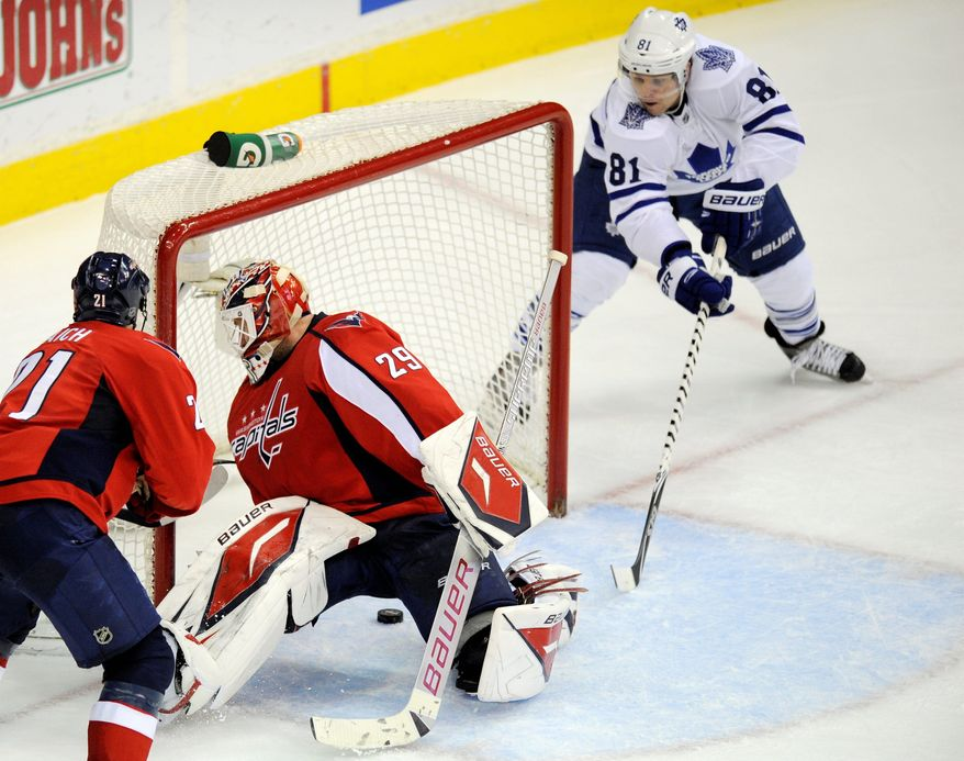 The Capitals' Tomas Vokoun has allowed some soft goals in recent games, including this tap-in by Toronto's Phil Kessel on Dec. 9. (Associated Press)
