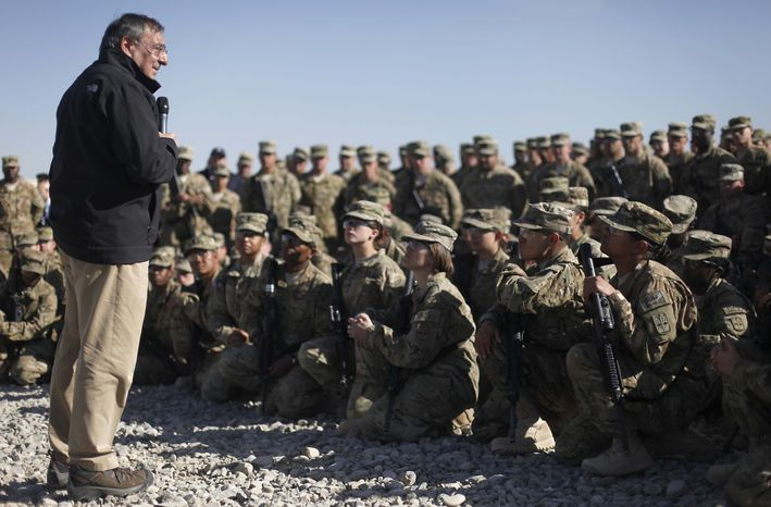 Secretary of Defense Leon E. Panetta presents Purple Hearts to personnel of the 172nd Infantry Brigade Task Force Blackhawks at a forward operating base in Sharana, Afghanistan, on Wednesday, Dec. 14, 2011. (AP Photo/Pablo Martinez Monsivais, Pool)