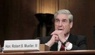 FBI Director Robert S. Mueller III testifies before the Senate Judiciary Committee on Capitol Hill in Washington on Wednesday, Dec. 14, 2011. (AP Photo/J. Scott Applewhite)