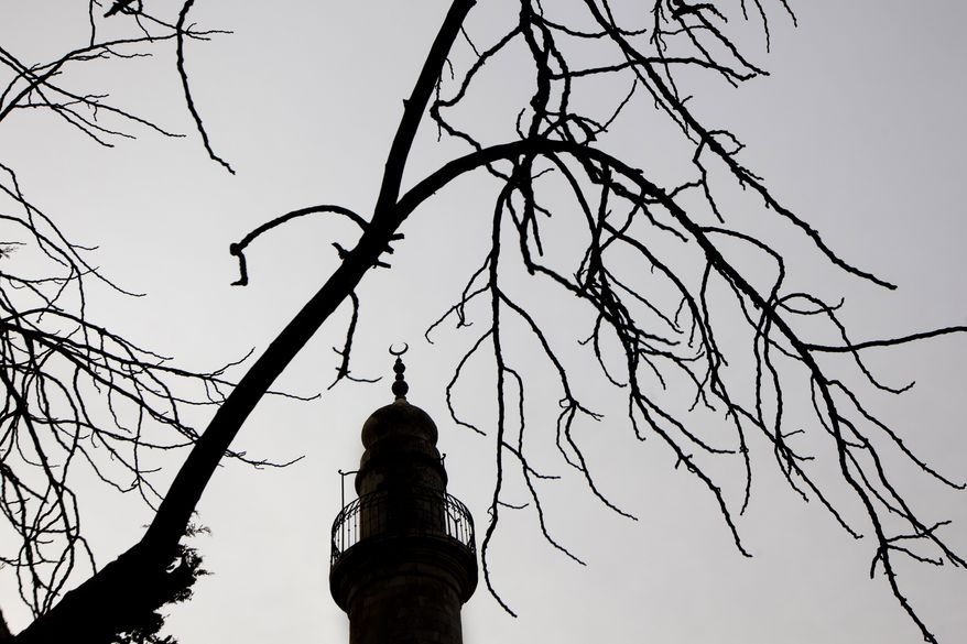 The minaret of a vandalized mosque in Jerusalem's Mea Shearim neighborhood is seen Dec. 14, 2011, after unknown arsonists torched the inactive mosque, provoking calls in Israel for a more effective crackdown on Jewish extremists suspected in a string of increasingly brazen acts of violence. (Associated Press)