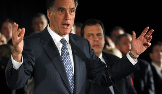 **FILE** Republican presidential candidate former Massachusetts Gov. Mitt Romney, left, gestures during a speech as New Jersey Gov. Chris Christie listens at a fundraising event in Parsippany, N.J., Monday, Dec. 12, 2011. (AP Photo/Rich Schultz)
