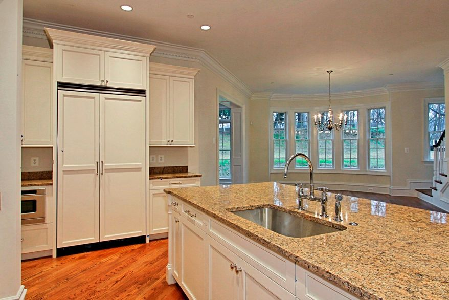 The kitchen opens to the family dining room, which has a bay window.