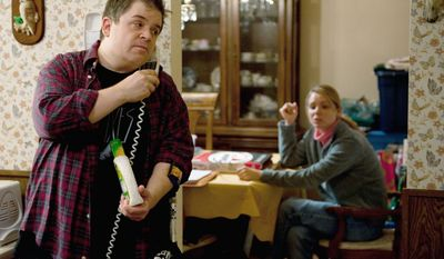 "Patton Oswalt (left) portrays Matt Freehauf and Collette Wolfe portrays Sandra Freehauf in a scene from ""Young Adult."" (Paramount Pictures via Associated Press)"