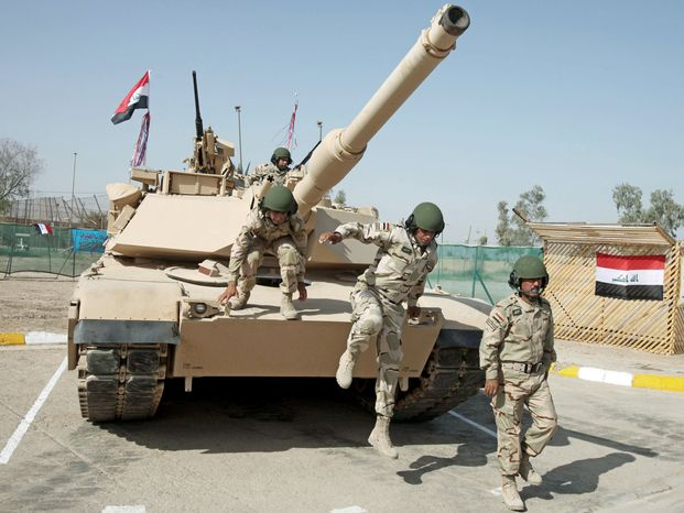 ON THEIR OWN: Iraqi army soldiers train with an M1 Abrams tank, purchased from the U.S., during an exercise in Baghdad.
