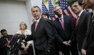 ** FILE ** House Speaker John Boehner of Ohio, center, accompanied by fellow Republican leaders, meets with reporters on Capitol Hill in Washington, Tuesday, Dec. 13, 2011, before a crucial vote on a GOP effort to renew an extension of the payroll-tax cut. (AP Photo/J. Scott Applewhite)