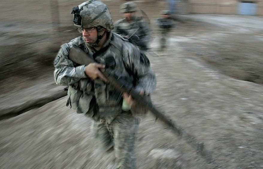 """In this Dec. 23, 2007 file photo, U.S. army soldiers from Blackfoot Company, 2nd Battalion, 23rd Infantry Regiment, run to take defensive positions during a firefight on the outskirts of Muqdadiyah, in the volatile Diyala province, about 90 kilometers (60 miles) north of Baghdad. In the beginning, it all looked simple: topple Saddam Hussein, destroy his purported weapons of mass destruction and lay the foundation for a pro-Western government in the heart of the Arab world. Nearly 4,500 American and more than 100,000 Iraqi lives later, the objective now is simply to get out _ and leave behind a country where democracy has at least a chance, where Iran does not dominate and where conditions may not be good but """"good enough."""" (AP Photo/Marko Drobnjakovic, File)"""