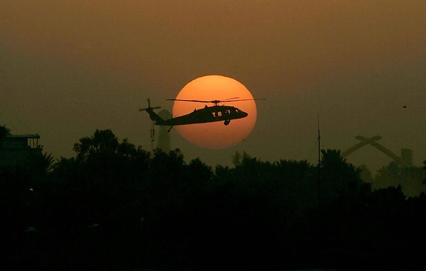 "In this Tuesday, Oct 30, 2007 file photo, a U.S. army Black Hawk helicopter flies as the sun sets over Baghdad. In the beginning, it all looked simple: topple Saddam Hussein, destroy his purported weapons of mass destruction and lay the foundation for a pro-Western government in the heart of the Arab world. Nearly 4,500 American and more than 100,000 Iraqi lives later, the objective now is simply to get out _ and leave behind a country where democracy has at least a chance, where Iran does not dominate and where conditions may not be good but ""good enough."" (AP Photo/Marko Drobnjakovic)"