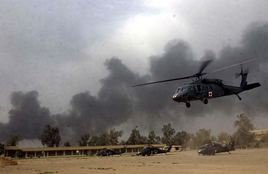 A U.S. Navy medevac Blackhawk helicopter takes off from the Republican Guard Training Academy in Baghdad on Wednesday, April 9, 2003. (J.M. Eddins Jr./The Washington Times)