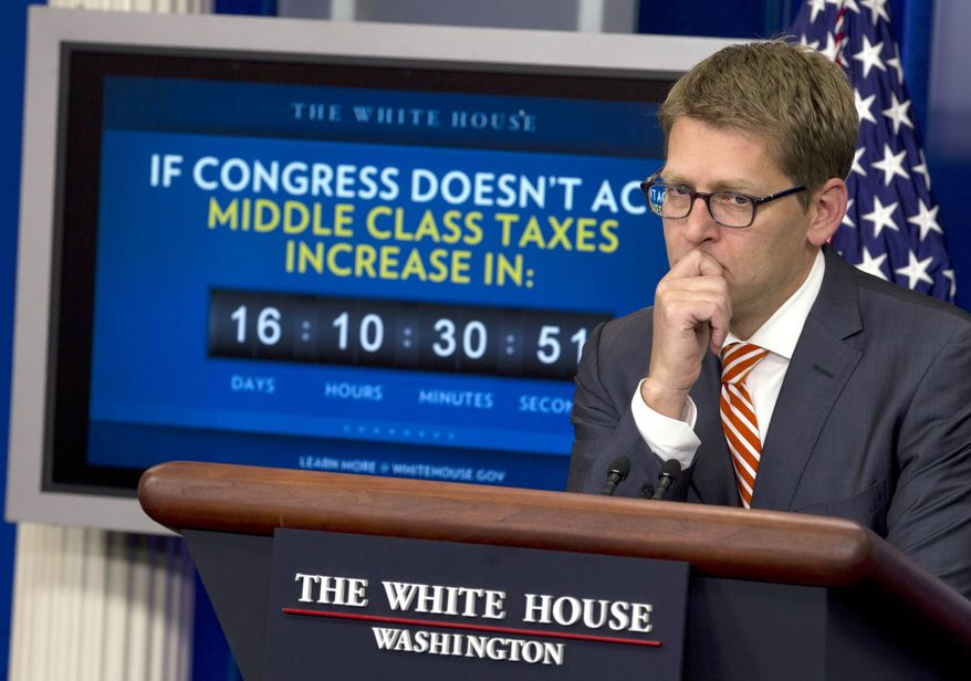 White House press secretary Jay Carney listens to a question during his daily news briefing at the White House on Dec. 15, 2011. (Associated Press)