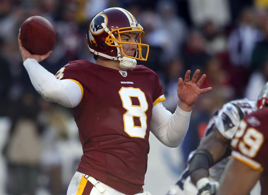 Washington Redskins quarterback Rex Grossman (8) delivers a pass against the New England Patriots during the first half of an NFL football game on Sunday, Dec. 11, 2011, in Landover, Md. (AP Photo/Evan Vucci)