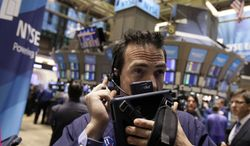 Trader Gregory Rowe works on the floor of the New York Stock Exchange on Dec. 15, 2011. (Associated Press)