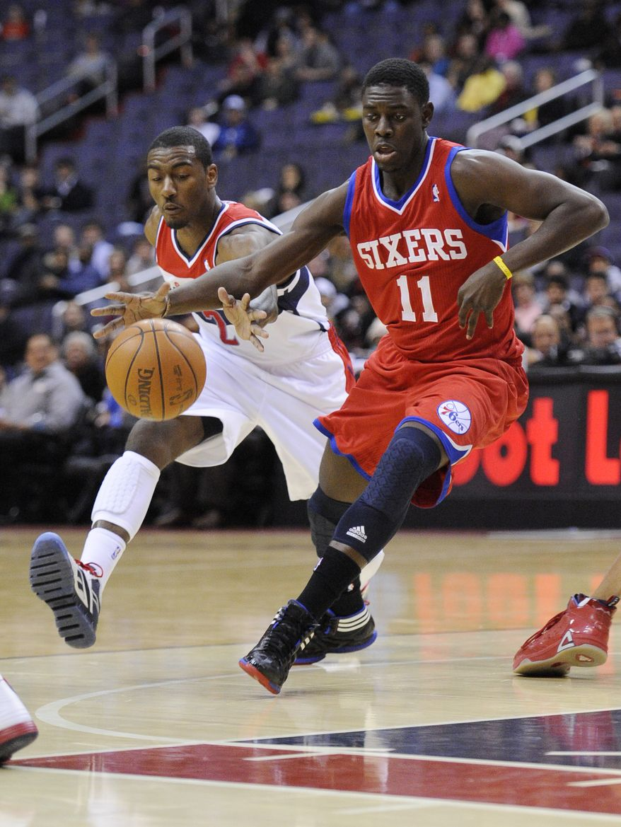 Washington Wizards point guard John Wall disappointed in the team's 2011-12 preseason debut, turning the ball over six times, while scoring eight points and recording three assists. The Wizards lost 103-78 to the Philadelphia 76ers. (AP Photo/Nick Wass)