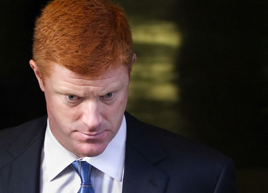 Penn State assistant football coach Mike McQueary leaves the Dauphin County Court in Harrisburg, Pa., on Dec 16, 2011. McQueary, speaking for the first time in public about the 2002 encounter in a Penn State locker room, said he believes that Jerry Sandusky was attacking a child with his hands around the boy's waist but said he wasn't completely sure it was intercourse. (Associated Press/The Patriot-News)