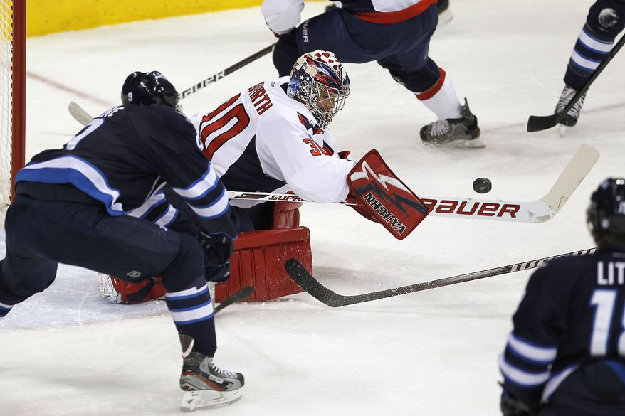 Washington Capitals goaltender Michal Neuvirth made 26 saves in his shutout of the Winnipeg Jets on Thursday night. He'll get the start between the pipes Saturday night against the Colorado Avalanche. (AP Photo/The Canadian Press, John Woods)