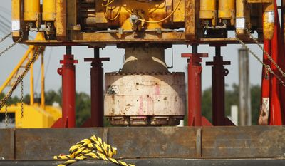 **FILE** The bottom of the blowout preventer stack, from the Deepwater Horizon explosion and oil spill, which is being examined as evidence for federal investigations, is seen Sept. 13, 2010, at the NASA Michaud Assembly facility in New Orleans. (Associated Press)