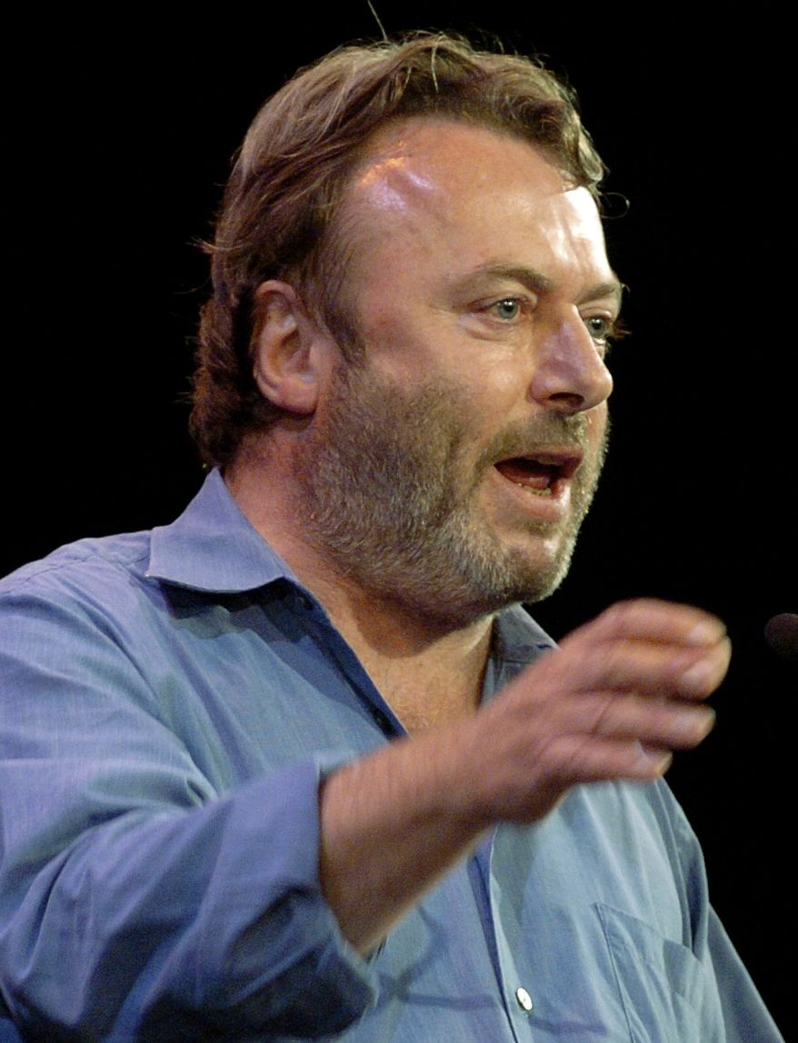 ** FILE ** Essayist Christopher Hitchens speaks during a debate on Iraq and the foreign policies of the United States and Britain, in this Sept. 14, 2005, file photo taken in New York. Vanity Fair reports Hitchens died on Thursday, Dec. 15, 2011. (AP Photo/Chad Rachman)