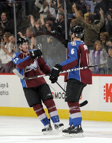 Colorado Avalanche right wing Milan Hejduk (23) congratulates teammate Erik Johnson (6) after Johnson scored a goal against the Washington Capitals during the second period Saturday, Dec. 17, 2011, in Denver. (AP Photo/Jack Dempsey)