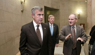 Republican Sens. Mike Johanns (left) of Nebraska, Johnny Isakson (center) of Georgia and James Risch of Idaho leave closed-door negotiations on the payroll tax cut extension and other measures on Dec. 16, 2011, at the Capitol. (Associated Press)