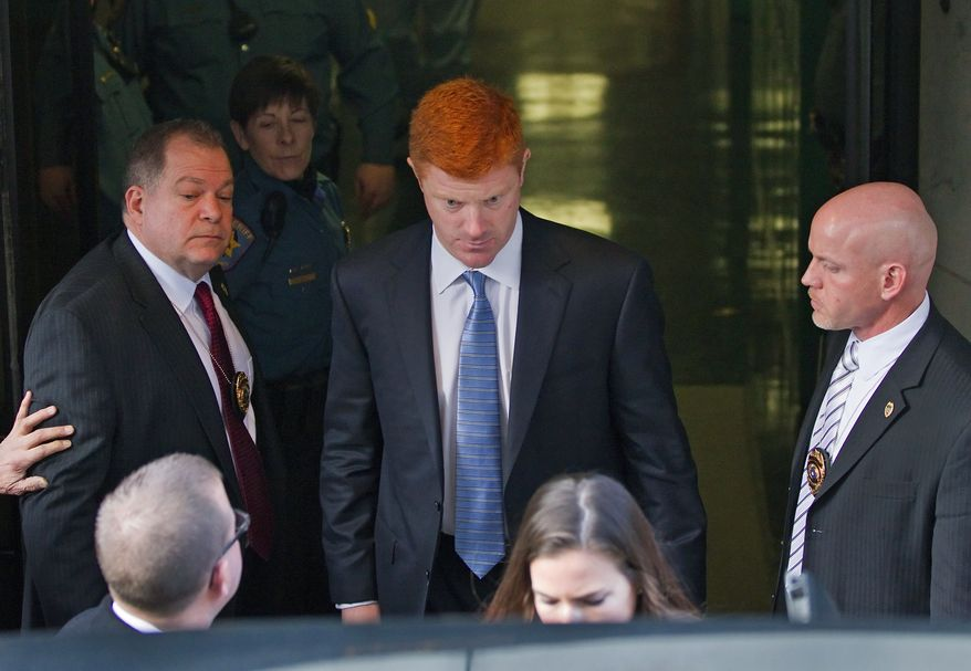 Penn State Assistant Football Coach Mike McQueary departs the Dauphin County Court Friday, Dec 16, 2011 in Harrisburg, Pa. McQueary, speaking for the first time in public about the 2002 encounter in a Penn State locker room, said he believes that Jerry Sandusky was attacking a child with his hands around the boy's waist but said he wasn't 100 percent sure it was intercourse. (AP Photo/The Patriot-News, Joe Hermitt)