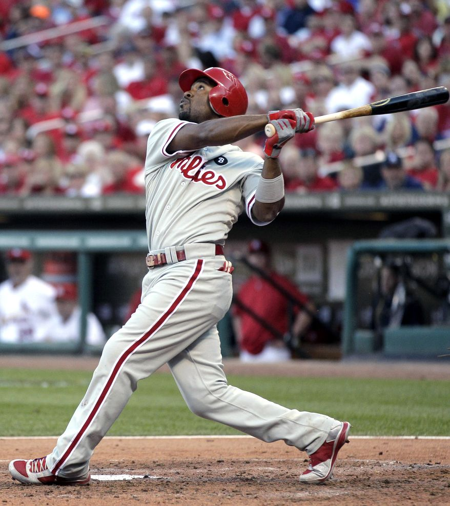 FILE - In this Oct. 4, 2011, file photo, Philadelphia Phillies' Jimmy Rollins bats during the sixth inning of Game 3 of baseball's National League division series against the St. Louis Cardinals in St. Louis. Two people familiar with the negotiations tell The Associated Press on Saturday, Dec. 17, that Rollins has agreed to a 3-year, $33 million contract with the Phillies. The deal includes a vesting option for a fourth year. The people spoke on condition of anonymity because the agreement is not official. (AP Photo/Charlie Riedel, File)