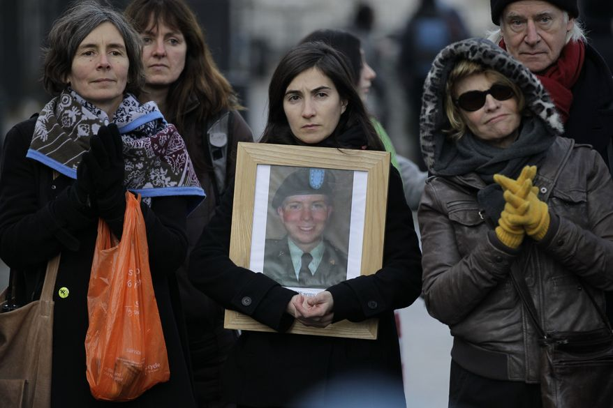 Supporters of U.S. soldier Private Bradley Manning listen to a speech as they protest outside the U.S. Embassy in London calling for his release, Saturday, Dec. 17, 2011. (AP Photo/Sang Tan)