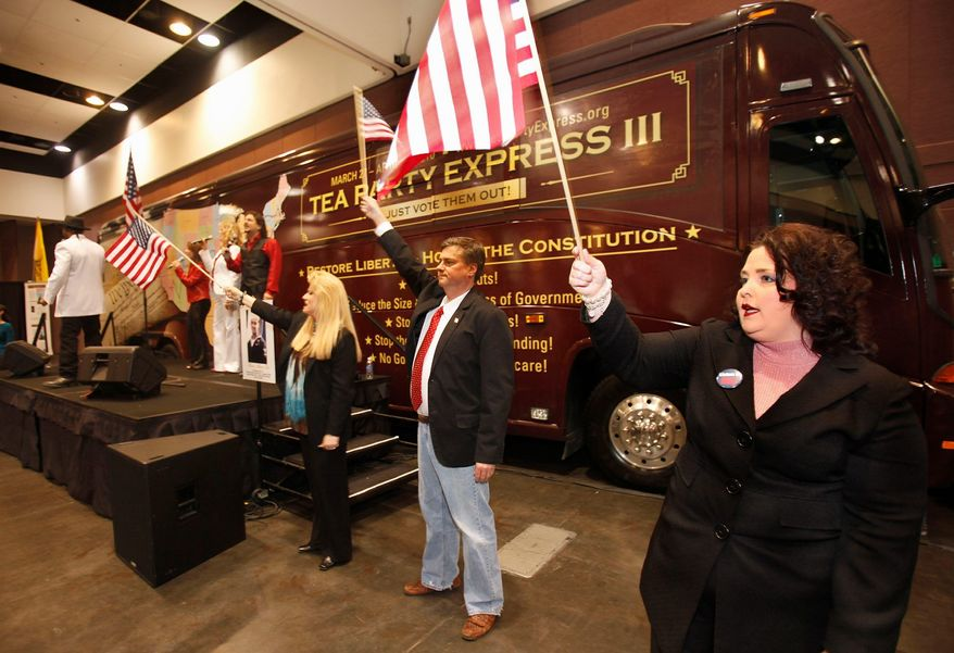 Amy Kremer (right) and Mark Williams (second from right) wave flags during the Tea Party Express rally at the state Republican convention in Santa Clara, Calif., on Saturday, March 13, 2010. (AP Photo/Tony Avelar)