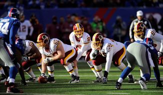 Despite throwing two interceptions, Redskins quarterback Rex Grossman had things well in hand. He finished 15 of 24 for 185 yards, including a 20-yard touchdown pass to Santana Moss during the second quarter. (Associated Press)